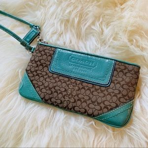 Small Coach wristlet, teal and tan